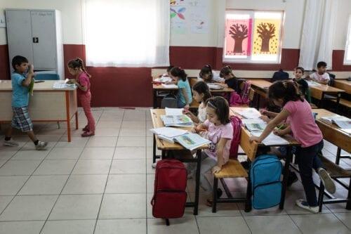Syrian refugee children attend 2nd degree class at the Kahramanmaras refugee camp's school on 19 September 2019 in [Kahramanmaras, Turkey. Burak Kara/Getty Images]