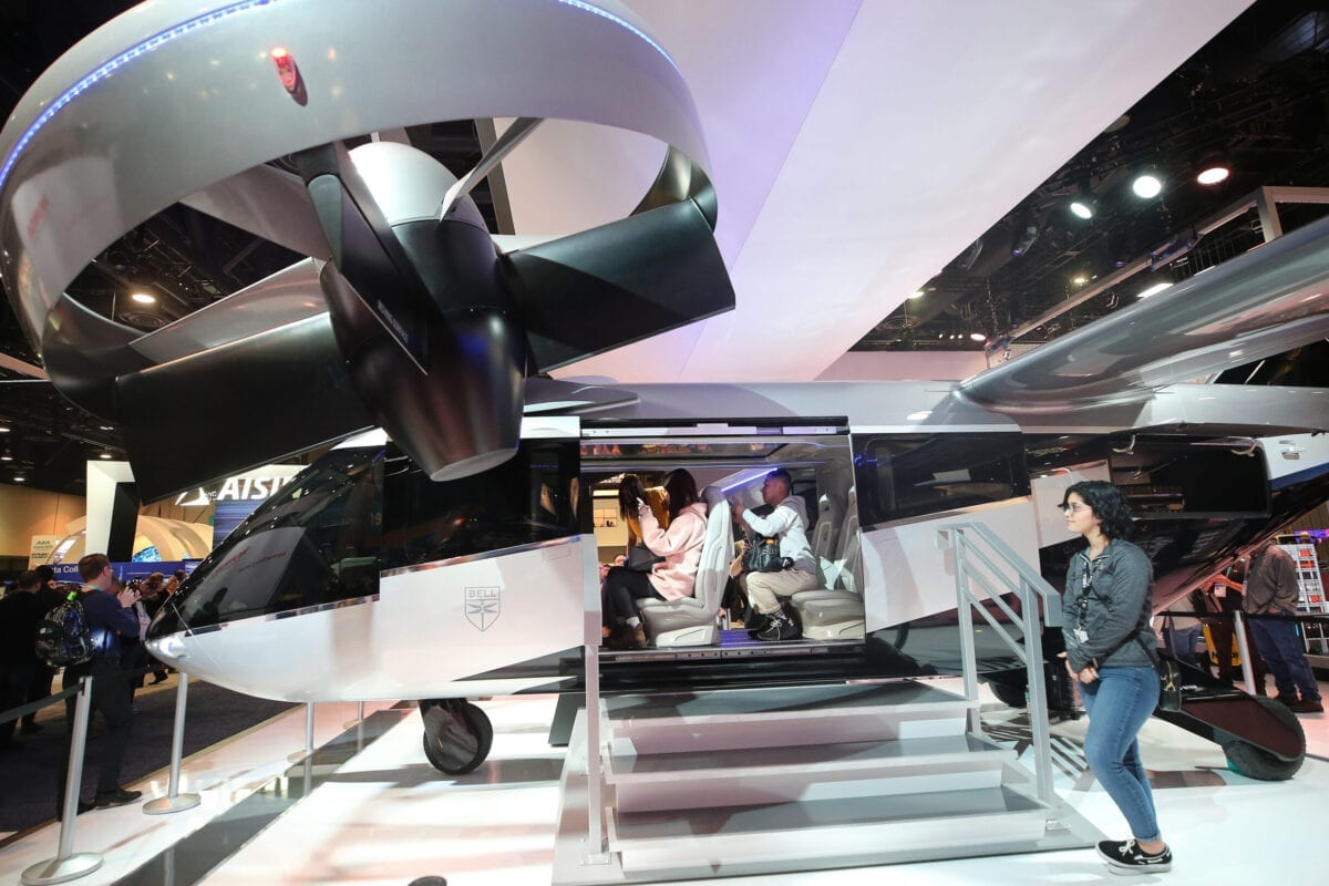 LAS VEGAS, NEVADA - JANUARY 08: Attendees (C) visit a full-scale mockup of the Bell Nexus 4EX air taxi concept at CES 2020 at the Las Vegas Convention Center on January 8, 2020 in Las Vegas, Nevada. Bell's new fully electric air taxi concept is designed to carry four or five passengers for a distance of up to 60 miles at a speed of around 150 mph. CES, the world's largest annual consumer technology trade show, runs through January 10 and features about 4,500 exhibitors showing off their latest products and services to more than 170,000 attendees. (Photo by Mario Tama/Getty Images)