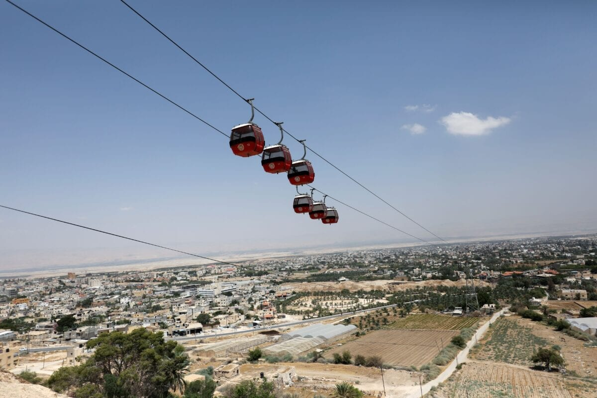 A picture taken on June 21, 2020, shows a view of a cable car overlooking the West Bank city of Jericho. - When Israeli Prime Minister Benjamin Netanyahu unveiled a map of his plans in September, he pointed to a long blue zone to be annexed, leaving a brown speck in the middle: Jericho. Now the city's farmers in the occupied West Bank fear being marooned on a scrap of Palestinian land if Israel forges ahead with its plans to annex the Jordan Valley. (Photo by ABBAS MOMANI / AFP) (Photo by ABBAS MOMANI/AFP via Getty Images)