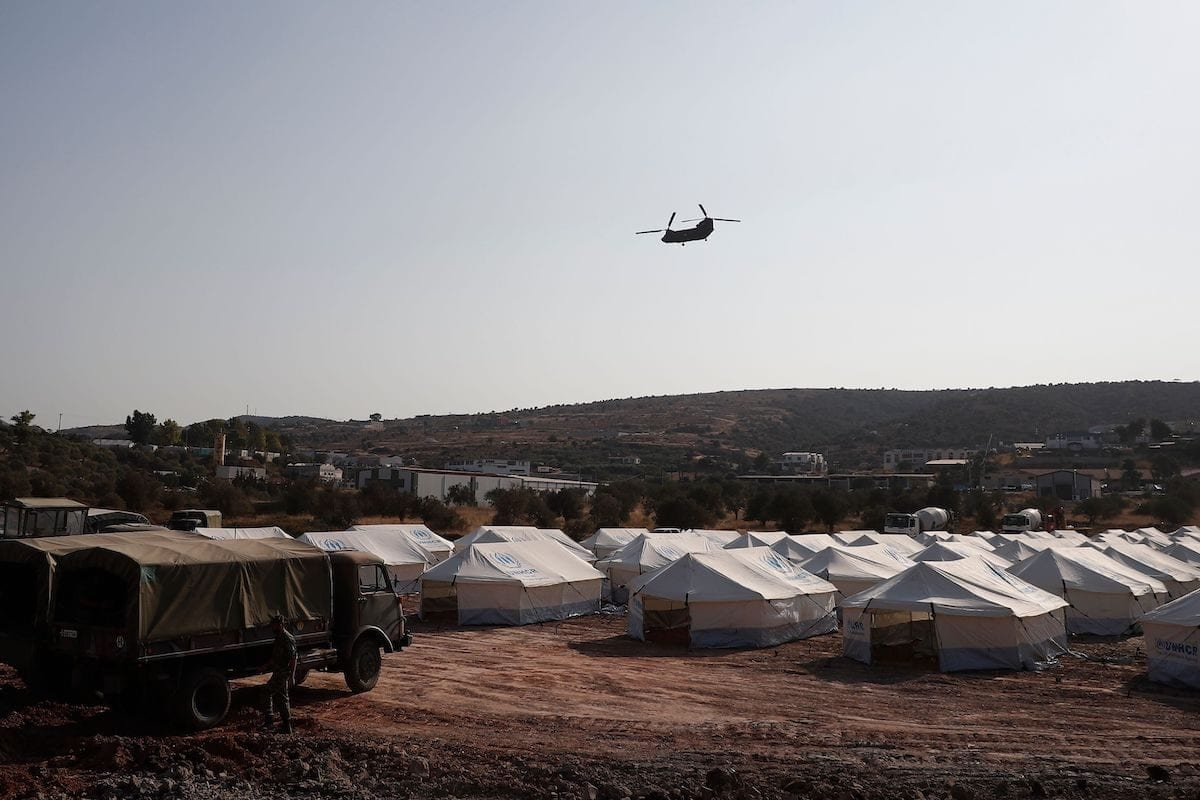 A Greek army's helicopter carrying European Council President flies over the new refugee and migrant camp near Kara Tepe, on the Greek island of Lesbos, on September 15, 2020. days after Europe's largest Moria camp on the island burnt down on September 15, 2020. [DIMITRIS TOSIDIS/POOL/AFP via Getty Images]