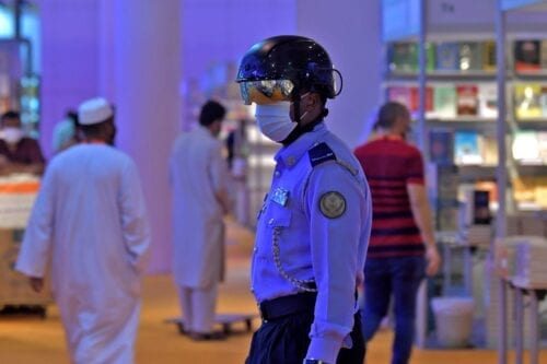 An Emirati policeman uses a smart helmet to detect people's temperature as a tool to fight the spread of the Covid-19 coronavirus among the visitors of the the Sharjah International Book Fair in Sharjah, northeast of Dubai, on November 4, 2020 [KARIM SAHIB/AFP via Getty Images]