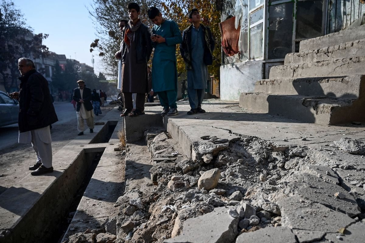 Residents gather at a site after several rockets land at Khair Khana, north west of Kabul on 21 November 2020. [WAKIL KOHSAR/AFP via Getty Images]