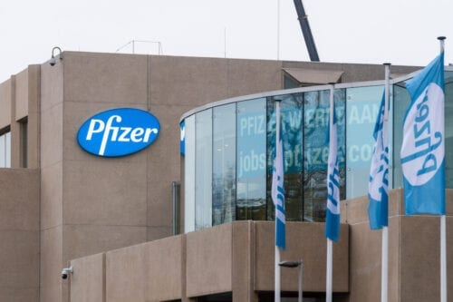 A banner from the Pfizer Pharmaceutical Company of Puurs, visible from the highway, lets motorists know that the company is hiring staff on 10 November 2020 in Puurs, Belgium. Pharmaceutical company Pfizer announced positive early results on its Covid-19 vaccine trial and has proven to be 90% effective in preventing infection of the virus. Pfizer, in partnership with Germany company BioNtech, plans to supply 1.3 billion doses of the vaccine in 2021. [Jean-Christophe Guillaume/Getty Images]
