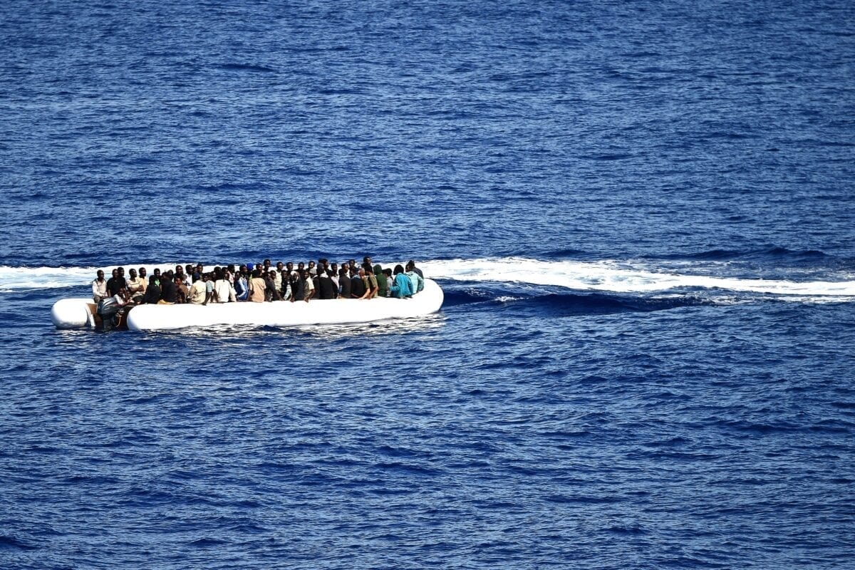 Migrants and refugees, mainly from Nigeria, Ghana, Senegal and Sierra Leone, wait to be rescued at sea and transported to the German navy frigate ship Werra, a part of the European external action service Eunavfor-med, on September 27, 2015. Eunavfor-med undertakes systematic efforts to identify, capture and dispose of vessels as well as enabling assets used or suspected of being used by migrant smugglers or traffickers in the southern central Mediteranean. AFP PHOTO / ALBERTO PIZZOLI (Photo credit should read ALBERTO PIZZOLI/AFP via Getty Images)