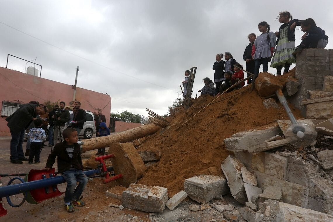 Palestinian children check the destruction in a children's playground, that was built with funding from Belgium, in the Zatarah village, south of the West Bank city of Nablus, after it was demolished on 12 April 2016 by Israeli authorities who said it was built in the so-called Area C, a closed military zone where Israel exercises full control. [JAAFAR ASHTIYEH/AFP via Getty Images]