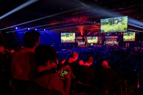 Visitors watch a game of an e-sport tournament in Germany on 25 January 2020 [Jens Schlueter/Getty Images]