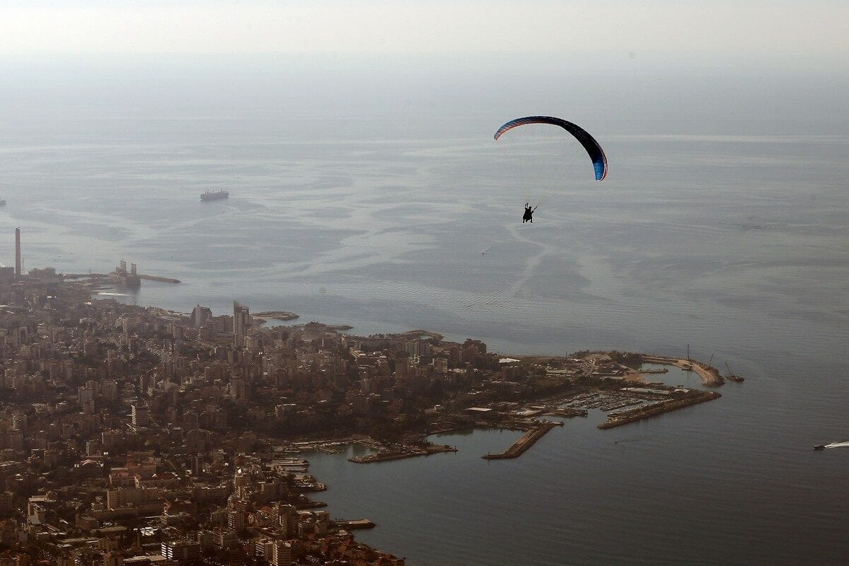 A paraglider flies above the area of Maameltein, in Lebanon 9 December 2015 [JOSEPH EID/AFP/Getty Images]