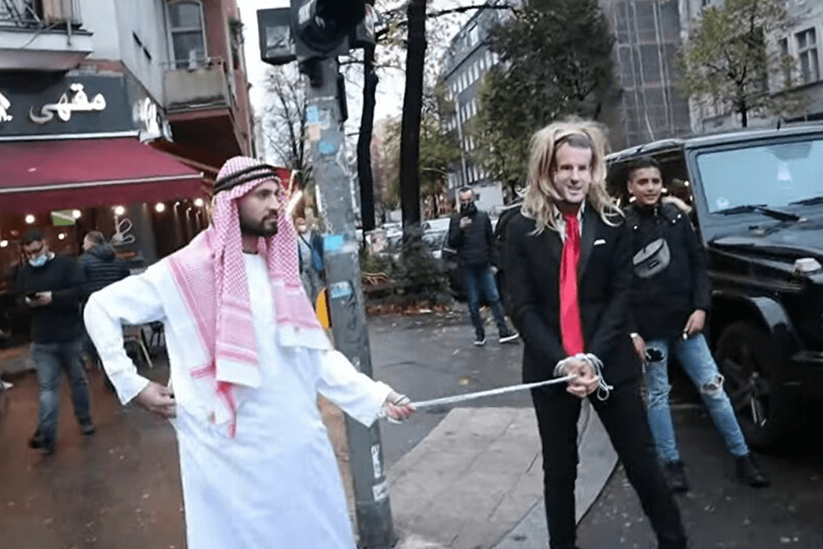 YouTuber Fayez Kanfash, drags 'Macron on Leash' through Berlin streets [Youtube]