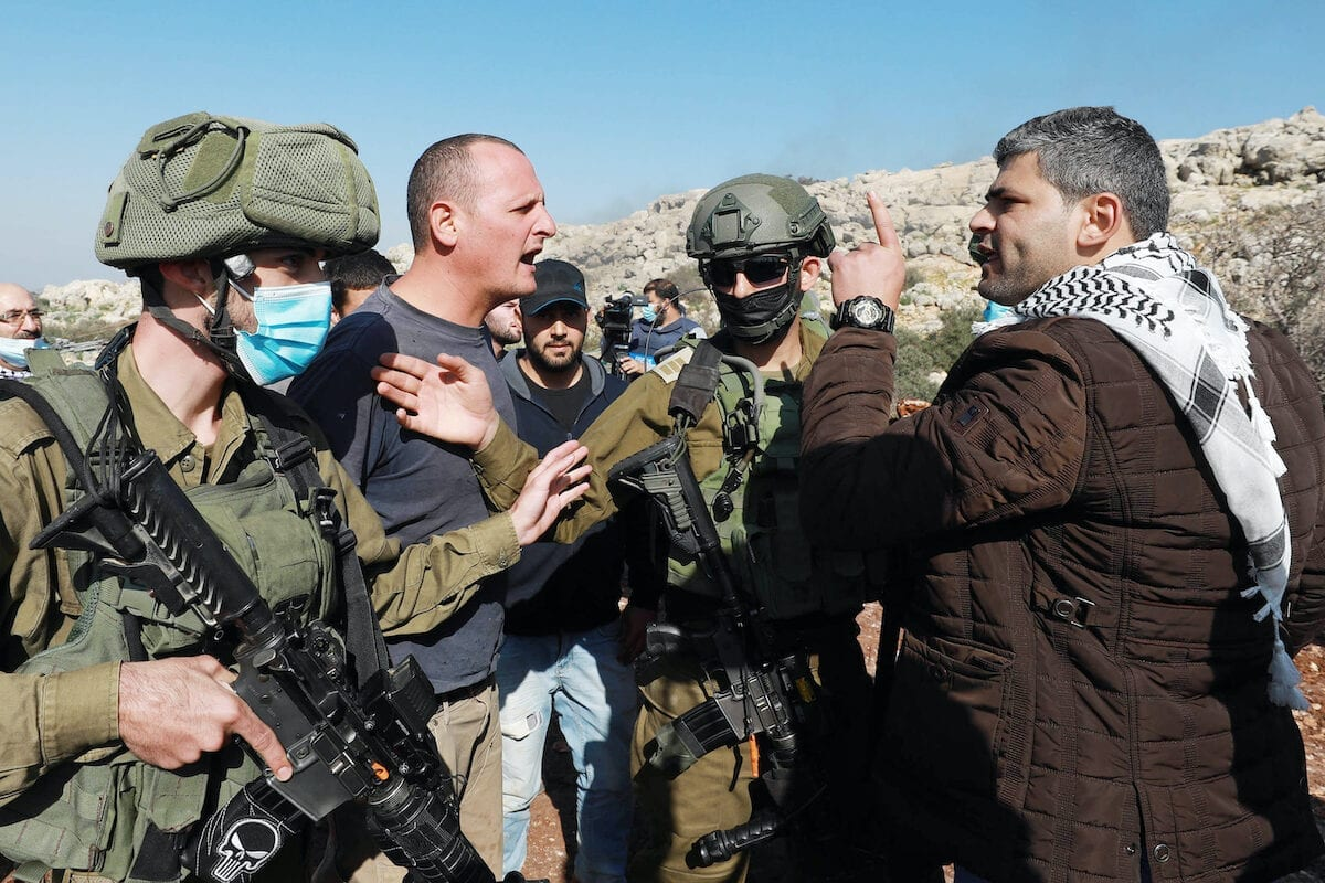 Israeli forces intervene in Palestinians reacting to Jewish settlers for trying to seize agricultural lands of Palestinians in al-Ras region in Selfit, West Bank on 30 November 2020. [Issam Rimawi - Anadolu Agency]