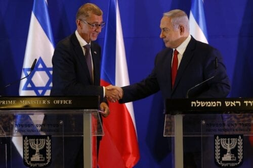 Czech Republic's Prime Minister Andrej Babis (L) and his Israeli counterpart Benjamin Netanyahu shake hands during a press conference after their meeting in Jerusalem, on 19 February 2019. [ARIEL SCHALIT/AFP via Getty Images]