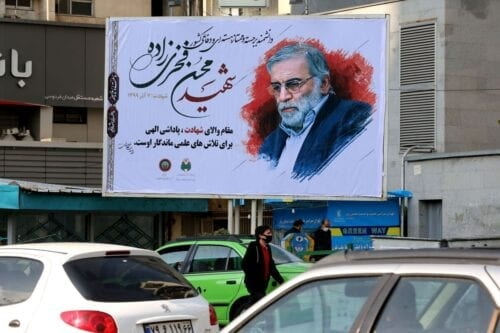 Vehicles drive by a billboard in honour of slain nuclear scientist Mohsen Fakhrizadeh in the Iranian capital Tehran, on November 30, 2020 [ATTA KENARE/AFP via Getty Images]